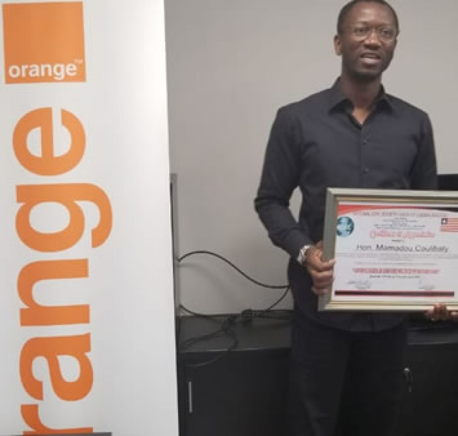 Orange-Liberia Chief Executive Officer, Mr. Mamadou Coulibaly Displaying his company's award