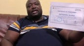 Mr. Nathaniel Blama, Liberia's First Confirmed COVID-19 Case Patient, Displaying His Certificate That He Has Recovered From The Virus-
