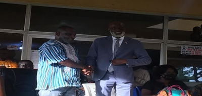 Photo Caption: New MICAT Boss Ledgerhood J. Rennie and former MICAT Boss Eugene Lenn Nagabe in a handshake at the program