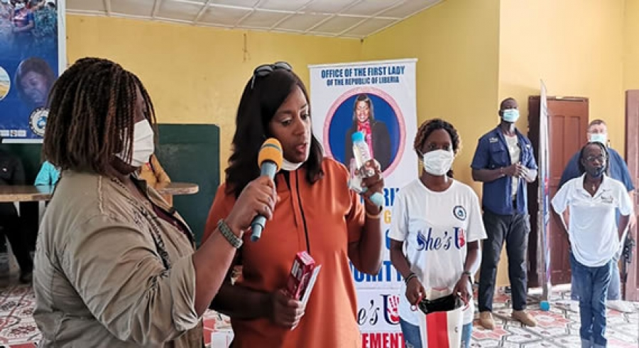 Liberia's First Lady Clar Marie Weah speaking during the distribution of the gifts